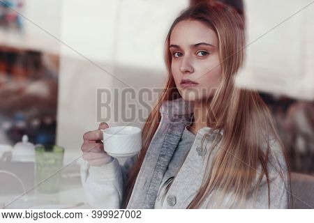 Blond Long Hair Girl Close Up Portrait Through The Cafe Window