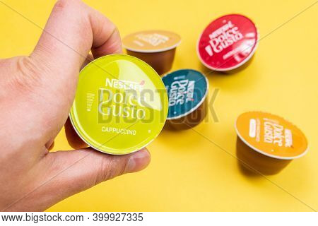 Tyumen, Russia-december 10, 2020: Nescafe Dolce Gusto Coffee Capsules, Close Up. On A Yellow Backgro
