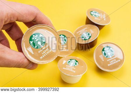 Tyumen, Russia-december 10, 2020: Starbucks Dolce Gusto Nescafe Espresso Coffee Capsules On Yellow B
