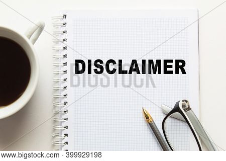 Notepad With Inscriptions Disclaimer On A White Background. Business Concept.