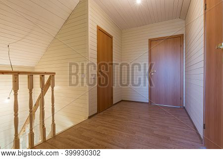 The Empty Hall Of New House After Construction And Renovation. Concept Of Housewarming And New Dwell