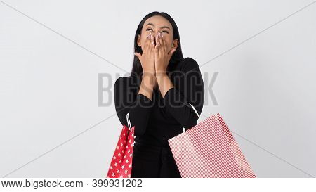 Happy Shopping Concept. Young Asian Thai Woman In Action Or Activity Of Purchasing Goods