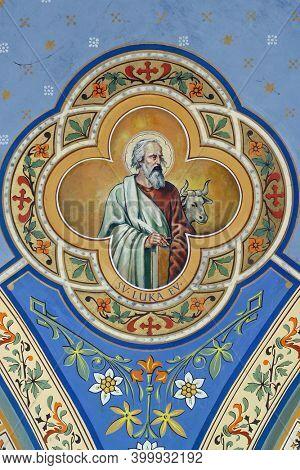 ZABOK, CROATIA - JULY 06, 2013: Saint Luke the Evangelist, fresco in the parish church of Helena in Zabok, Croatia
