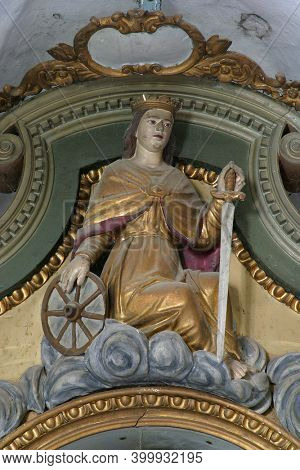 SLAVETIC, CROATIA - JULY 22, 2013: St. Catherine of Alexandria, statue on the altar of St. Barbara in the parish church of St. Anthony the Hermit in Slavetic, Croatia
