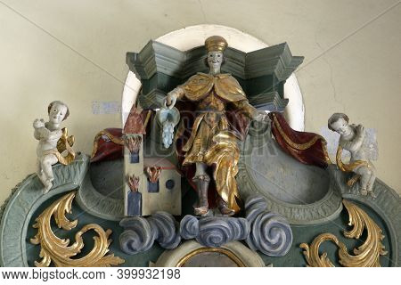 SLAVETIC, CROATIA - JULY 22, 2013: St. Florian, statue on the altar St. Valentine in the parish church of St. Anthony the Hermit in Slavetic, Croatia