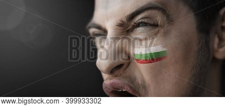 A Screaming Man With The Image Of The Countrys National Flag On His Face