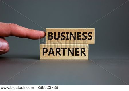 Business Partner Symbol. Wooden Blocks With Words 'business Partner' On Beautiful Grey Background. M