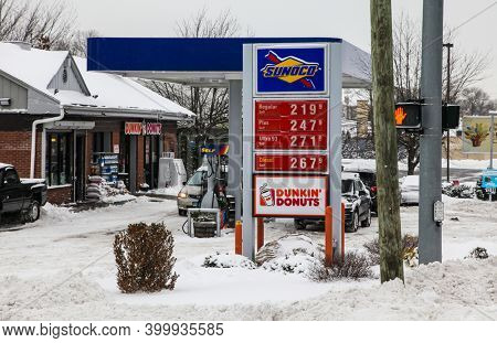 NORWALK, CT, USA-DECEMBER 17, 2020: Sunoco gas station on  Post road and Ferris Ave. corner in Norwalk after snow storm.