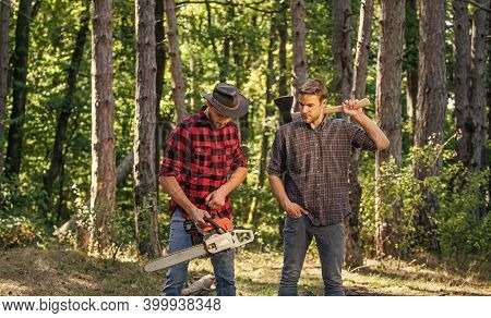 Best Way To Relax. Man Forester Use Saw And Axe. Search Firewood For Picnic Campfire. Surviving In W