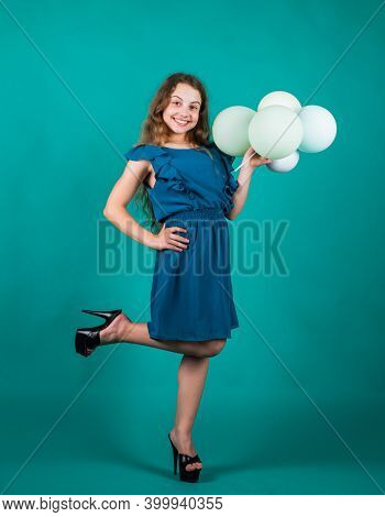 Smiling Child With Party Balloons. Childhood Happiness. Pretty Teenage Girl In Dress. Kid Formal Fas