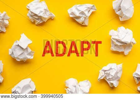 Adapt Text On Yellow Background With Copy Space. Crumpled Sheets Of Paper Lie Around. Business Conce