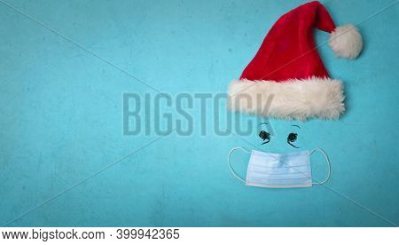 santa claus hat and mask on blue background