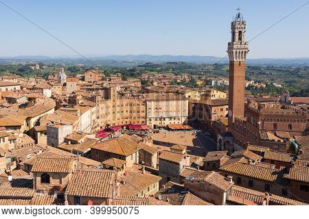 Top View Of Piazza Del Campo And The Rooftops Of Siena With Detail Of The Bell Tower, Palazzo Comuna