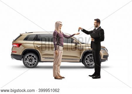 Salesman giving SUV car keys to a blond woman isolated on white background