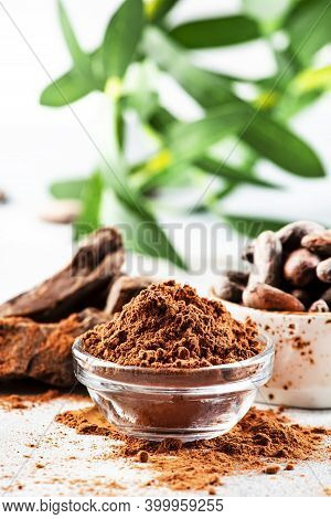 Organic Cocoa Powder, Cocoa Beans, Grated Cocoa Lump On Gray Background. Copy Space