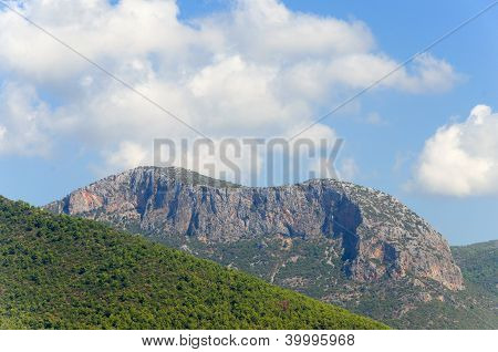 Forested mountains and clouds