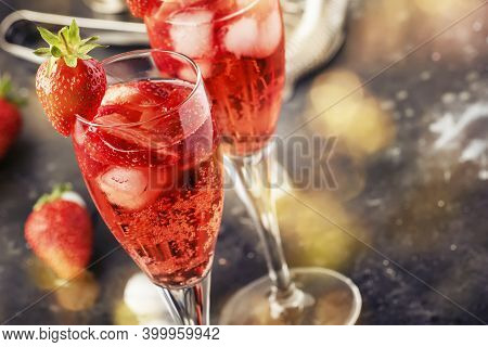 Rossini Italian Red Alcoholic Cocktail With Sparkling Wine, Strawberry Puree And Ice In Champagne Gl
