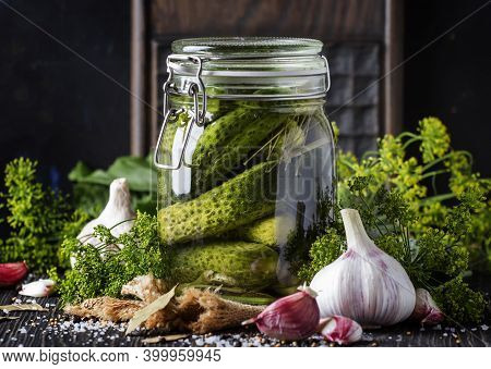 Homemade Marinated Or Pickled Cucumbers With Dill, Garlic And Spices In Big Glass Jar On Rustic Brow