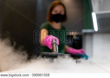 Woman Employee Cleaning Company Blows Vapor Out Of Steam Generator. Steam Cleaning Process For Kitch