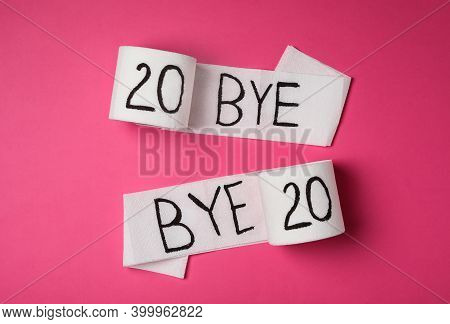 Toilet Paper With Text Bye Bye 2020 On Pink Background, Flat Lay
