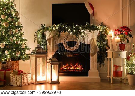 Beautiful Room Interior With Fireplace And Christmas Decor In Evening