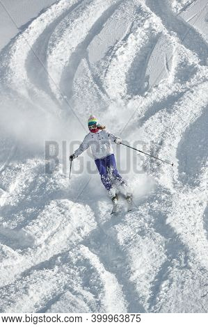 VALMOREL, FRANCE -CIRCA 2019: Skier coming down fast in fresh powder snow off-piste free ride. Plowing snow