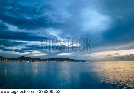 Landscape Of Vigo In Spain At Dusk With The City Lights On In The Background