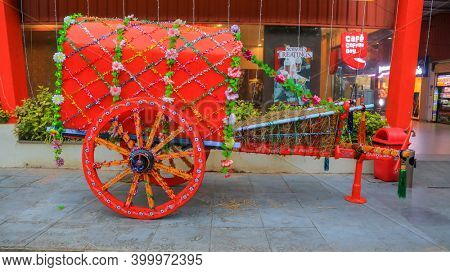 Suryapet, India - January 9, 2019 : Old traditionally decorated bullock cart in display in front of the store during pongal festival in India.