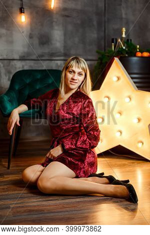 Cute Female Posing. Portrait Of Excited Beautiful Woman. Young Woman In Christmas Interior. Cozy Chr