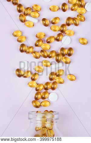 Close Up Vitamins And Supplements On Purple Background With Glass Bottle. Including Vitamin D3, Zinc