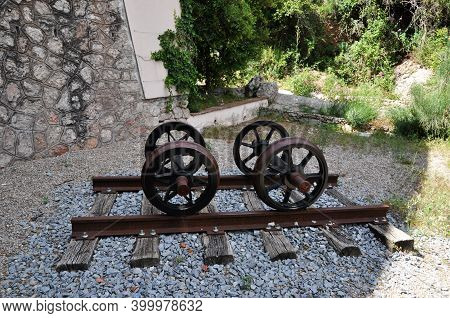 Wheeled Steam Locomotive On Rails. Old Wheels From A Steam Locomotive.