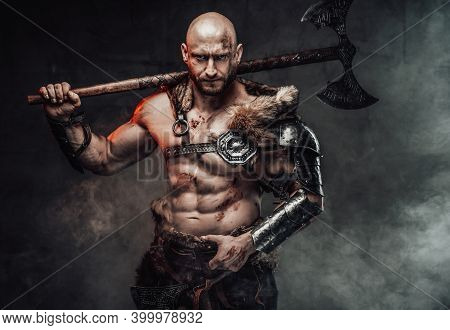Portrait Of A Viking Warrior With Grimy And Bloody Skin Dressed In Light Armour In Dark Smokey Backg