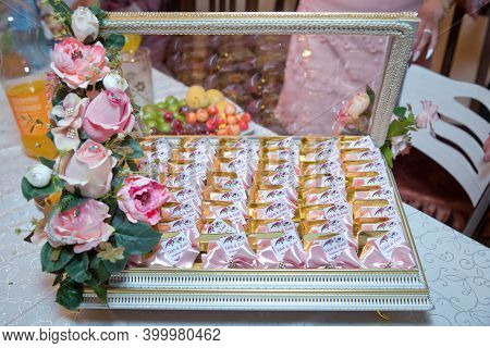Basket With Sweets Stands On The Table .the Handle Of The Engagement Basket . There Are Candies In T