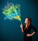 Pretty young lady smoking cigarette with colorful smoke poster