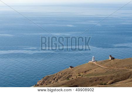 View to sea and lighthouse building