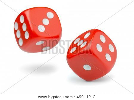 Two rolling red dice isolated on white