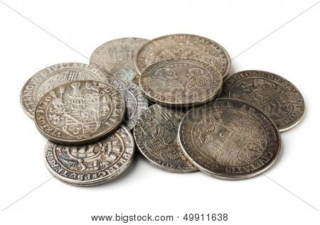 Pail of  thalers - ancient european silver coins isolated on white
