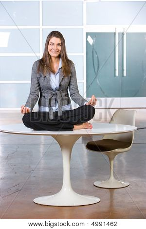 Business Woman Yoga In A Modern Office