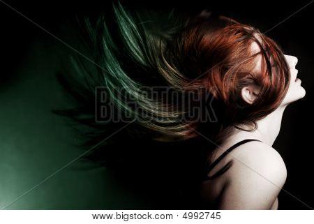 Attractive Model Swinging Her Hair.
