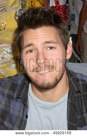 LOS ANGELES - AUG 23:  Scott Clifton at the Bold and Beautiful Fan Meet and Greet at the Farmers Market on August 23, 2013 in Los Angeles, CA