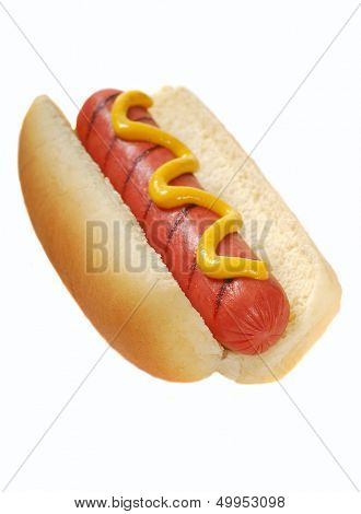 Freshly grilled hot dog with yellow mustard