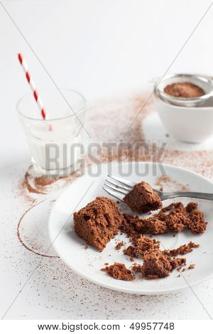 Chocolate Brownie On Plate Served With Milk And Sifter