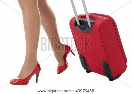 Young Woman Pulling a Suitcase