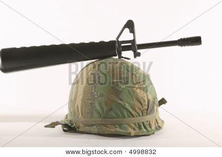 Vietnam Helmet And M16
