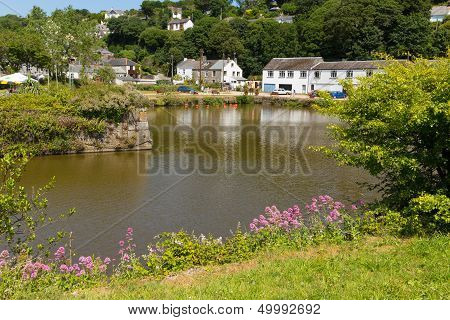 Pentewan village Cornwall England United Kingdom at the mouth of the St Austell River. poster