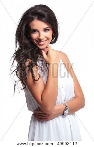 young beautiful woman smiling for the camera while holding her hand at her chin . isolated on a white background