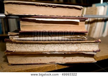 Old Books Lying On A Shelf In The Library
