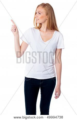 Woman Pointing And Looking At Copyspace