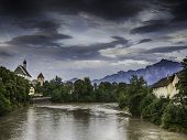 Picture of river Lech in Fussen with historic church and alps in Germany poster