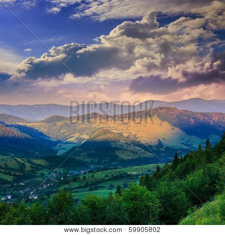 Village On Hillside Meadow With Forest In Mountain In The Morning